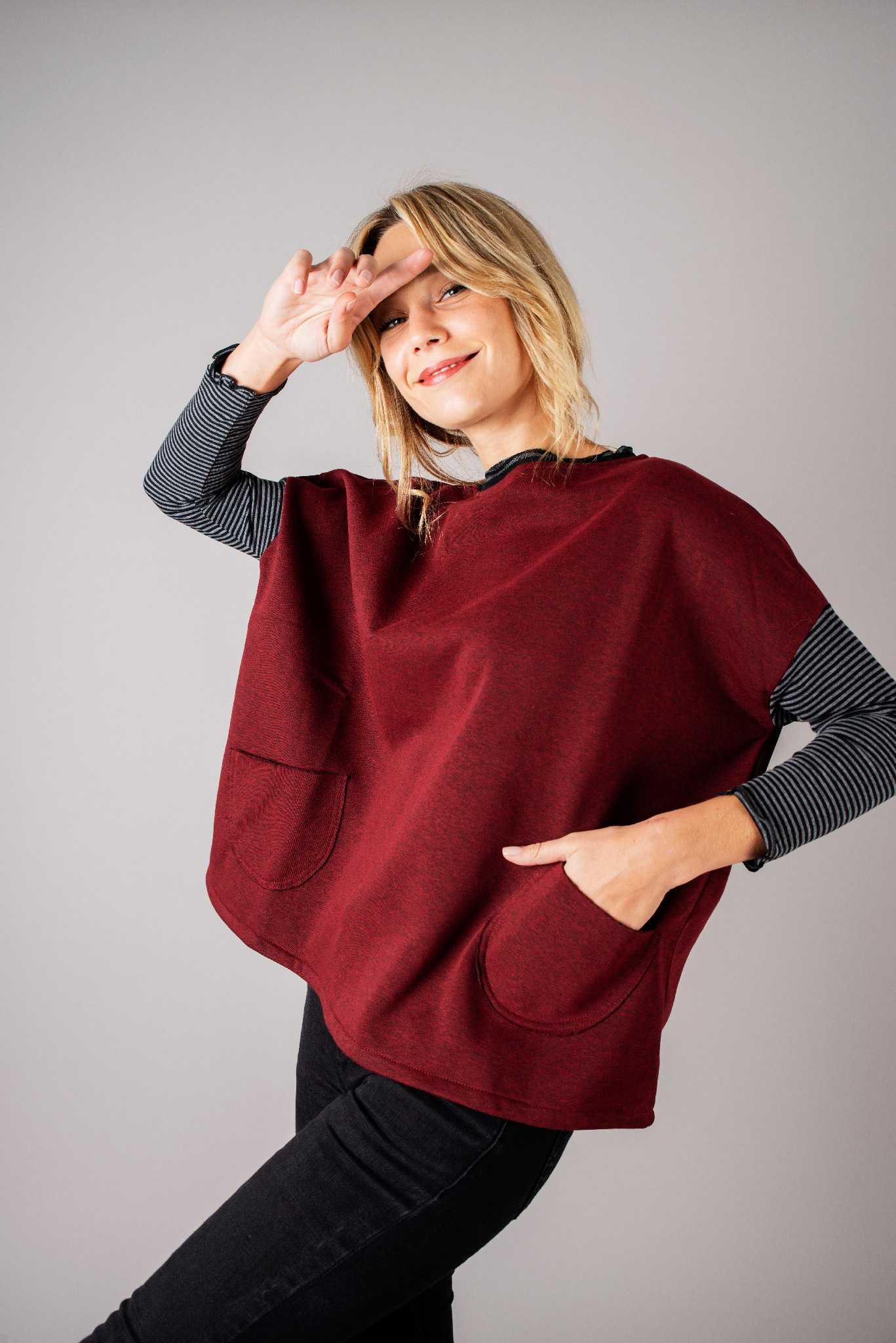 Pull poches sweat rouge